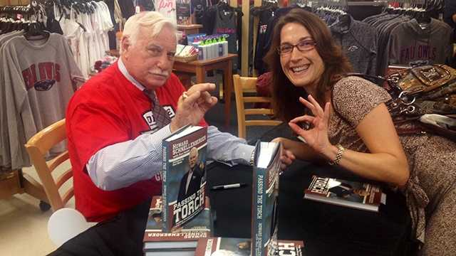 Legendary coach Howard Scnellenberger signed books for fans Friday during a signing at Florida Atlantic University.