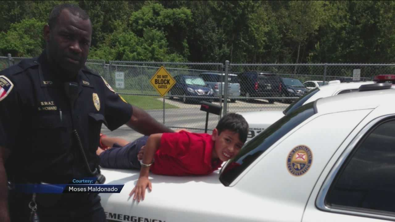 A photo showing a 10-year-old boy with autism handcuffed and propped up on the back of a Kissimmee police cruiser is making the rounds on social media.