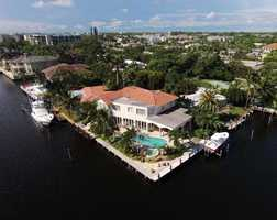 This opulent property not only accommodates boats, but also a fabulous lifestyle with delightful views. Begin your tour of the 3,998 sq. ft. property now.