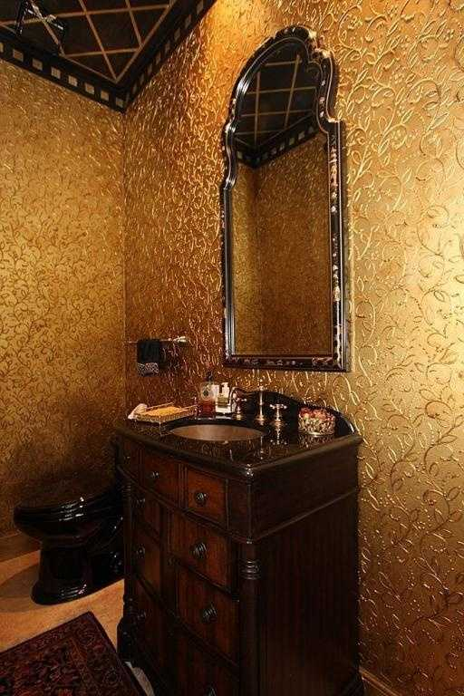 This half bathroom for guests can be described in two words-- bold and fancy.