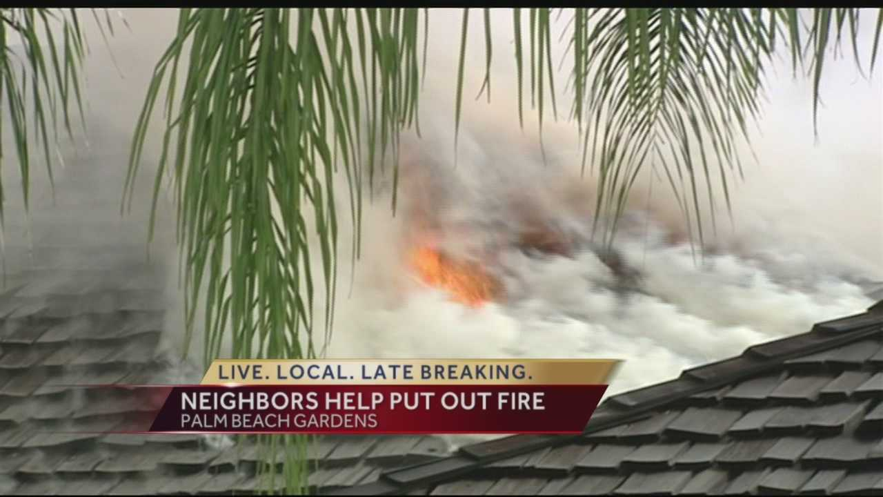 Neighbors came to the rescue Tuesday when a house quickly went up in flames in Palm Beach Gardens along Calais Circle.