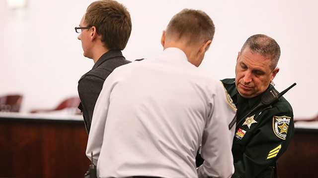 """Travis Van Vliet, """"Juror 100"""", is taken into custody for contempt of court and handcuffed. He was reportedly overhead talking about a 'retrial' in the hall Thursday, October 9, 2014 during jury selection in Tampa."""