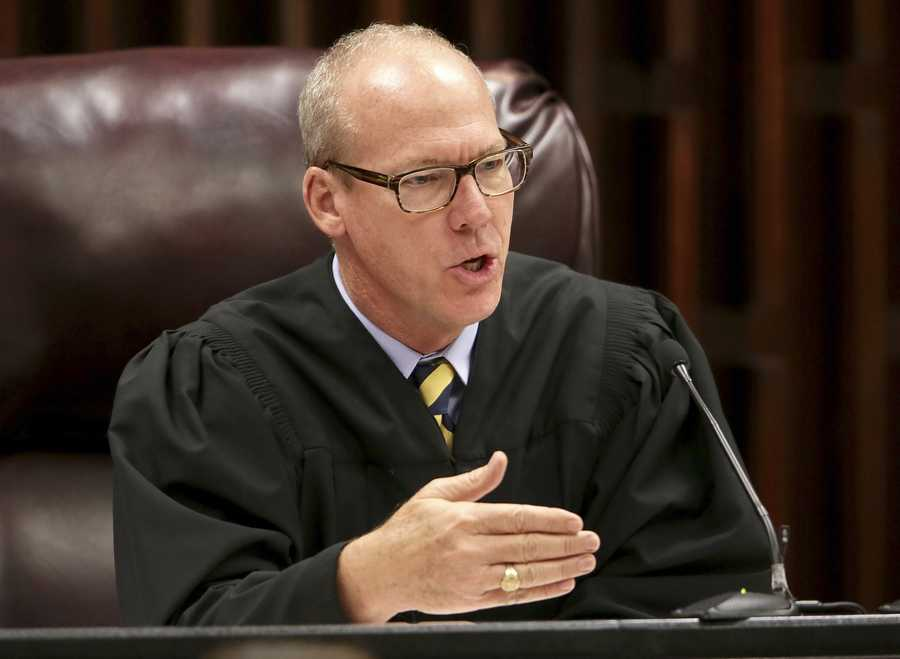 "Chief Circuit Judge Jeffrey Colbath quizzes ""Juror 100"" before taking him to custody for contempt of court and handcuffed. He was reportedly overhead talking about a 'retrial' in the hall Thursday, October 9, 2014 during jury selection in Tampa. (Lannis Waters / The Palm Beach Post"