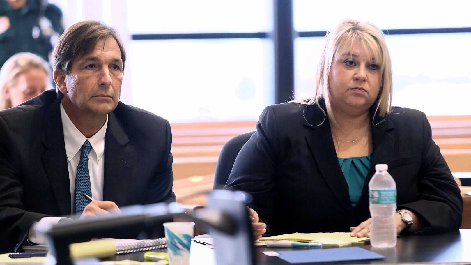 "John Goodman and attorney Elizabeth Parker listen to Judge Colbath question a juror Monday, October 13, 2014 about an incident that happened outside her balcony over the weekend where she said 3 people told her, in her words, that she was ""going to jail like Van Fleet"". John Goodman is charged with DUI manslaughter in the death of Scott Wilson. (Lannis Waters / The Palm Beach Post)"
