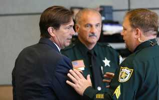 John Goodman talks with deputies as the court breaks for lunch Saturday, October 11, 2014. John Goodman is charged with DUI manslaughter in the death of Scott Wilson. (Lannis Waters / The Palm Beach Post)