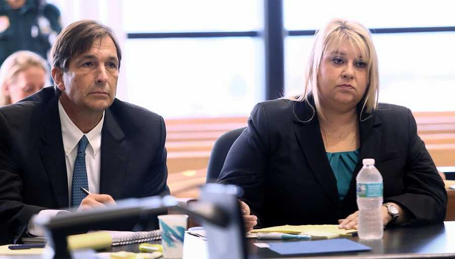 """John Goodman and attorney Elizabeth Parker listen to Judge Colbath question a juror Monday, October 13, 2014 about an incident that happened outside her balcony over the weekend where she said 3 people told her, in her words, that she was """"going to jail like Van Fleet"""". John Goodman is charged with DUI manslaughter in the death of Scott Wilson. (Lannis Waters / The Palm Beach Post)"""