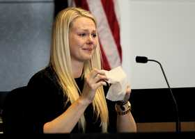 Candice Freel talks about being at the crash scene and how she wanted to jump into the canal, even though the dispatchers told her not to. Freel wells up in tears as she thinks about how she wanted to jump into the canal, but didn't, on the second day of John Goodman's retrial Monday, October 13, 2014. Goodman is charged with DUI manslaughter in the death of Scott Wilson. (Lannis Waters / The Palm Beach Post)