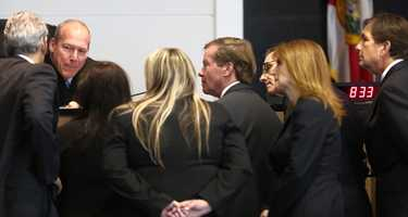 John Goodman, right, listens as Judge Colbath talks with attorneys about an incident a juror had at her hotel over the weekend, at the start of the second day of Goodman's retrial Monday, October 13, 2014. Goodman is charged with DUI manslaughter in the death of Scott Wilson. (Lannis Waters / The Palm Beach Post)