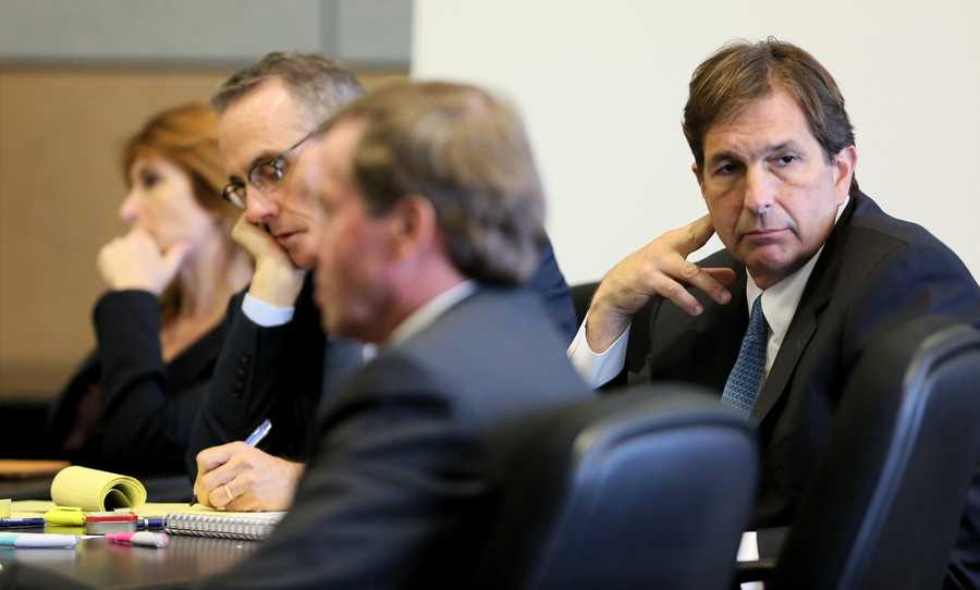 John Goodman sits with his attorneys Tama Kudman, Scott Richardson and Douglas Duncan during on the second day of John Goodman's retrial Monday, October 13, 2014. Goodman is charged with DUI manslaughter in the death of Scott Wilson. (Lannis Waters / The Palm Beach Post)