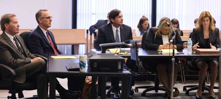 John Goodman and his defense team sit in court before the start of the fourth day of his retrial Wednesday, October 15, 2014. From left are Douglas Duncan, Scott Richardson, Goodman, Elizabeth Parker and Tama Kudman. Goodman is charged with DUI manslaughter in the death of Scott Wilson. (Lannis Waters / The Palm Beach Post)
