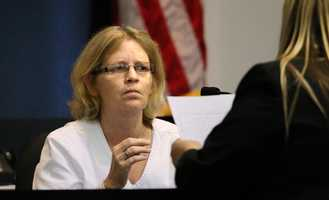 Defense attorney Elizabeth Parker hands witness Cecelia Betts, the nurse who drew John Goodman's blood at Wellington Medical Center after the crash, a copy of her previous statements during the fourth day of Goodman's retrial Wednesday, October 15, 2014. Goodman is charged with DUI manslaughter in the death of Scott Wilson. (Lannis Waters / The Palm Beach Post)