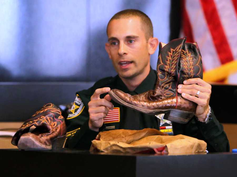 Robert Stephan, a traffic homicide investigator with PBSO, points out distinctive features of John Goodman's boots as he testifies on the fifth day of John Goodman's retrial Thursday, October 16, 2014. Goodman is charged with DUI manslaughter in the death of Scott Wilson. (Lannis Waters / The Palm Beach Post)