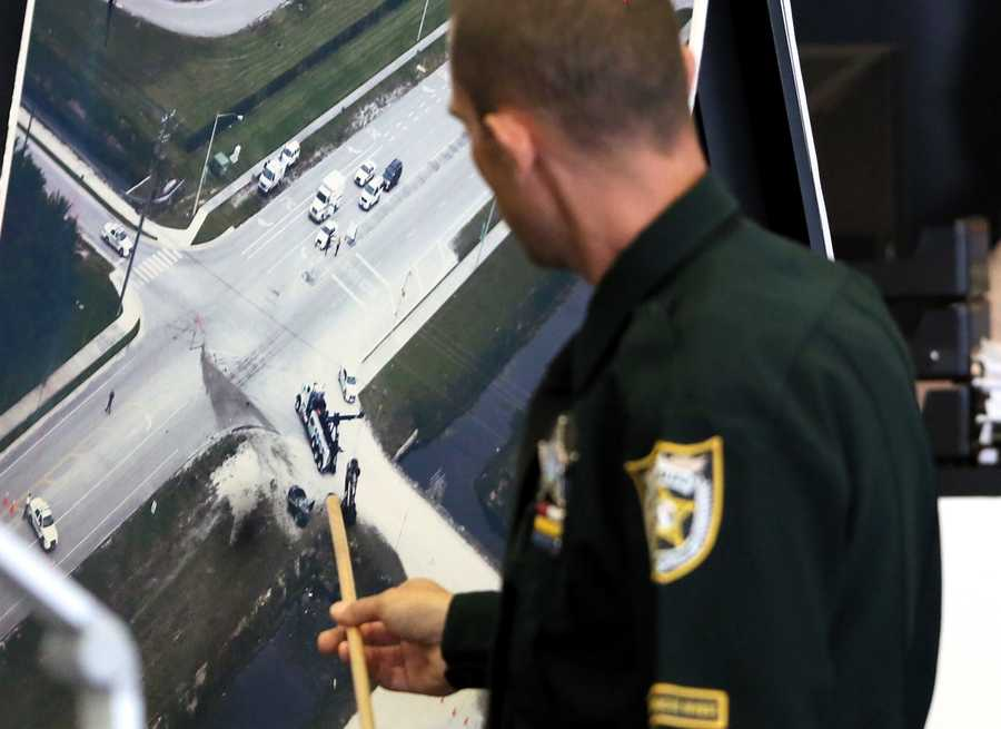Robert Stephan, a traffic homicide investigator with PBSO, points out where he spotted footprints leading away from John Goodman's Bentley as he testifies on the fifth day of Goodman's retrial Thursday, October 16, 2014. Goodman is charged with DUI manslaughter in the death of Scott Wilson. (Lannis Waters / The Palm Beach Post)