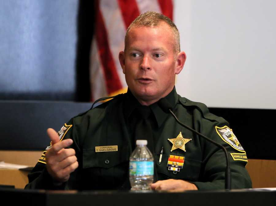 PBSO investigator Troy Snelgrove testifies during the sixth day of John Goodman's retrial Friday, October 17, 2014. Goodman is charged with DUI manslaughter in the death of Scott Wilson. (Lannis Waters / The Palm Beach Post)
