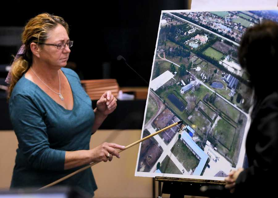 Ruth Poulsen, who leased the farm where Lisa Pembleton lived, points out the spot where she saw three men who were walking toward her barn from Kris Kampsen's property jump the fence. Poulsen is testifying in John Goodman's retrial Monday, October 20, 2014. Goodman is charged with DUI manslaughter in the death of Scott Wilson. (Lannis Waters / The Palm Beach Post)