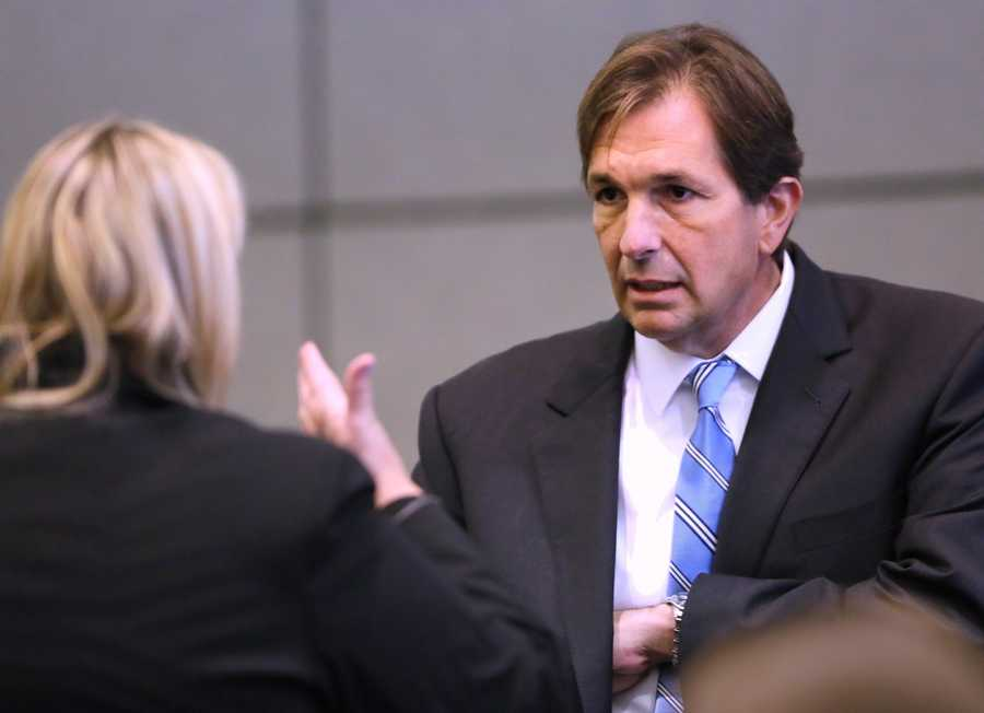 John Goodman talks with defense attorney Elizabeth Parker in court on the tenth day of his retrial Wednesday, October 22, 2014. Goodman is charged with DUI manslaughter in the death of Scott Wilson. (Lannis Waters / The Palm Beach Post)