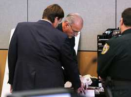 John Goodman is fingerprinted in the courtroom Tuesday after the jury found him guilty October 28, 2014.  (Lannis Waters / The Palm Beach Post)