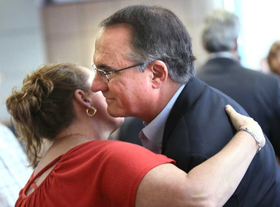William Wilson, father of Scott Wilson, is hugged after John Goodman was found guilty of DUI manslaughter with failure to render aid in the death of Scott Wilson. (Lannis Tuesday, October 28, 2014 after the jury Waters / The Palm Beach Post)