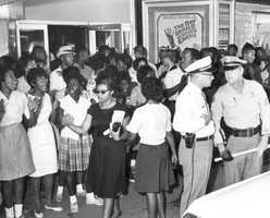 Crowd picketing segregation laws at the State Theatre in Tallahassee on May 29, 1963.