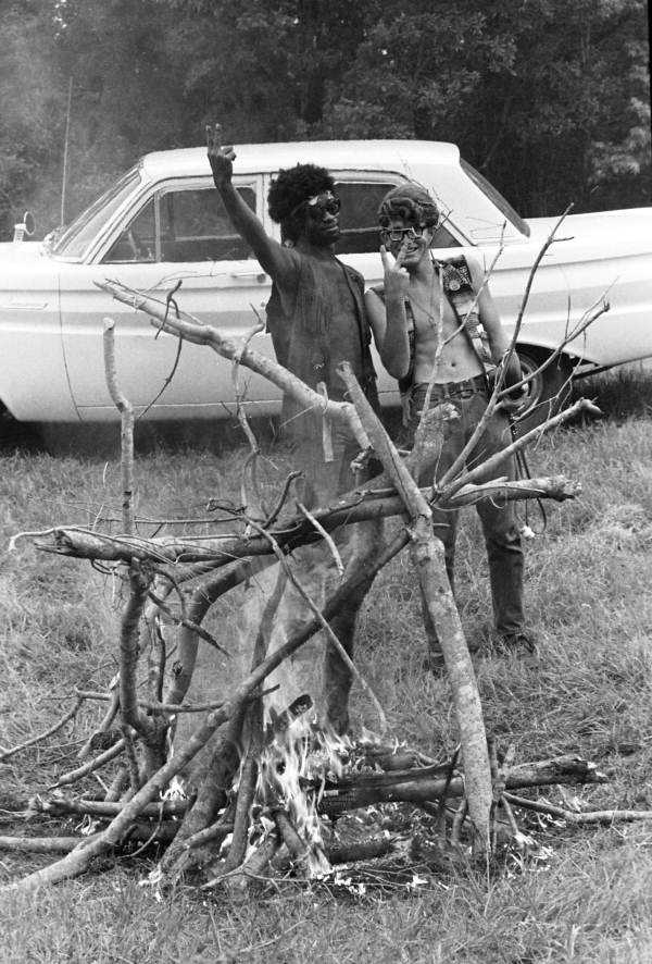 Young men at the 1970 Florida Folk Festival giving the peace or victory sign in White Springs.