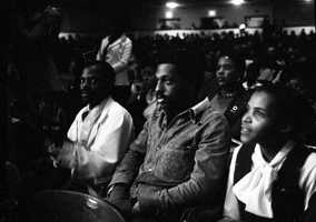 View showing audience in auditorium listening to civil rights speakers, including Tallahassee civil rights leader Reverend C.K. Steele and Jesse Jackson.