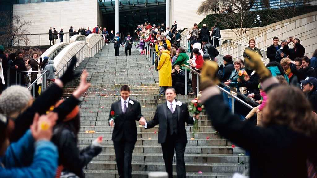 Just married couples leaving Seattle City Hall are greeted by well-wishers on the first day of same-sex marriage in Washington state.
