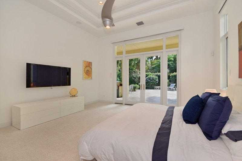 Master bedroom also boasts a contemporary style, plus private access to the outdoors.