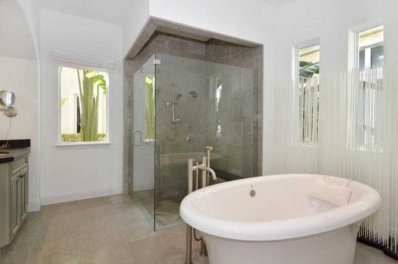 This bathroom, is like your own personal spa. Enjoy the free standing tub, spacious glass shower, and the flooding sunlight.