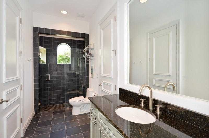 Renovated bathroom with beautifully tiled shower.