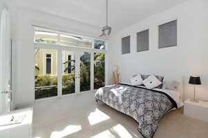 Sleek, modern master bedroom suite.