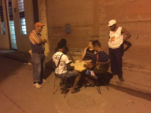 Dominoes in the street at night.