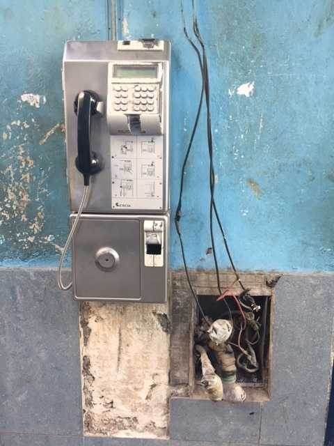 Phones on walls of houses on nearly every block in Cuba.