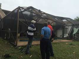 National Weather Service of Miami surveys the damage in Boca Raton from Thursday morning's line of strong storms.