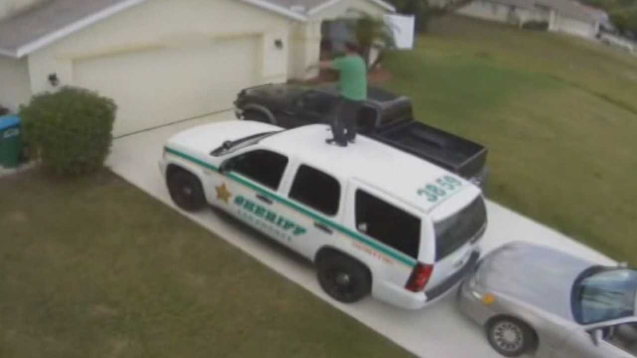 A man was caught on video dancing on a deputy's patrol cruiser in Cape Coral.