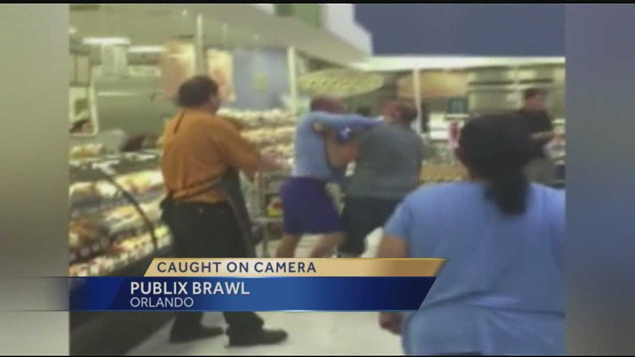 A shocking scene was captured inside an Orlando Publix Super Market store as two grown men began throwing punches in the deli department.