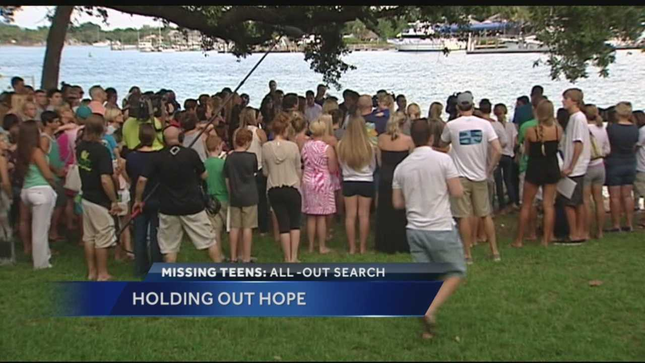 More than 100 people gather at Lighthouse Park in Jupiter Tuesday night to pray for the safety of missing teens Austin Stephanos and Perry Cohen. Ari Hait reports.