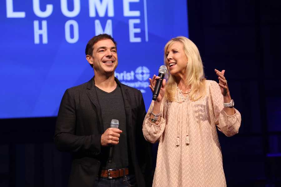 """Lead Pastors Todd and Julie Mullins say """"Welcome Home"""" to the thousands of people who attended service."""