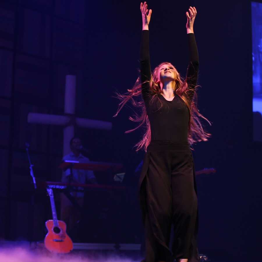Faith Newcomb performs a dance during worship.