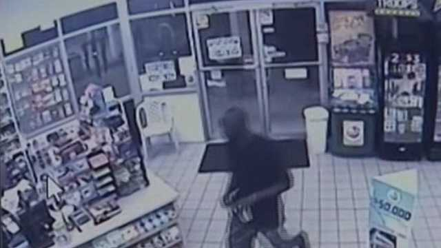 Surveillance video caught a man robbing a convenience store in West Palm Beach Sunday, making off with cash, a phone and a cup of coffee.