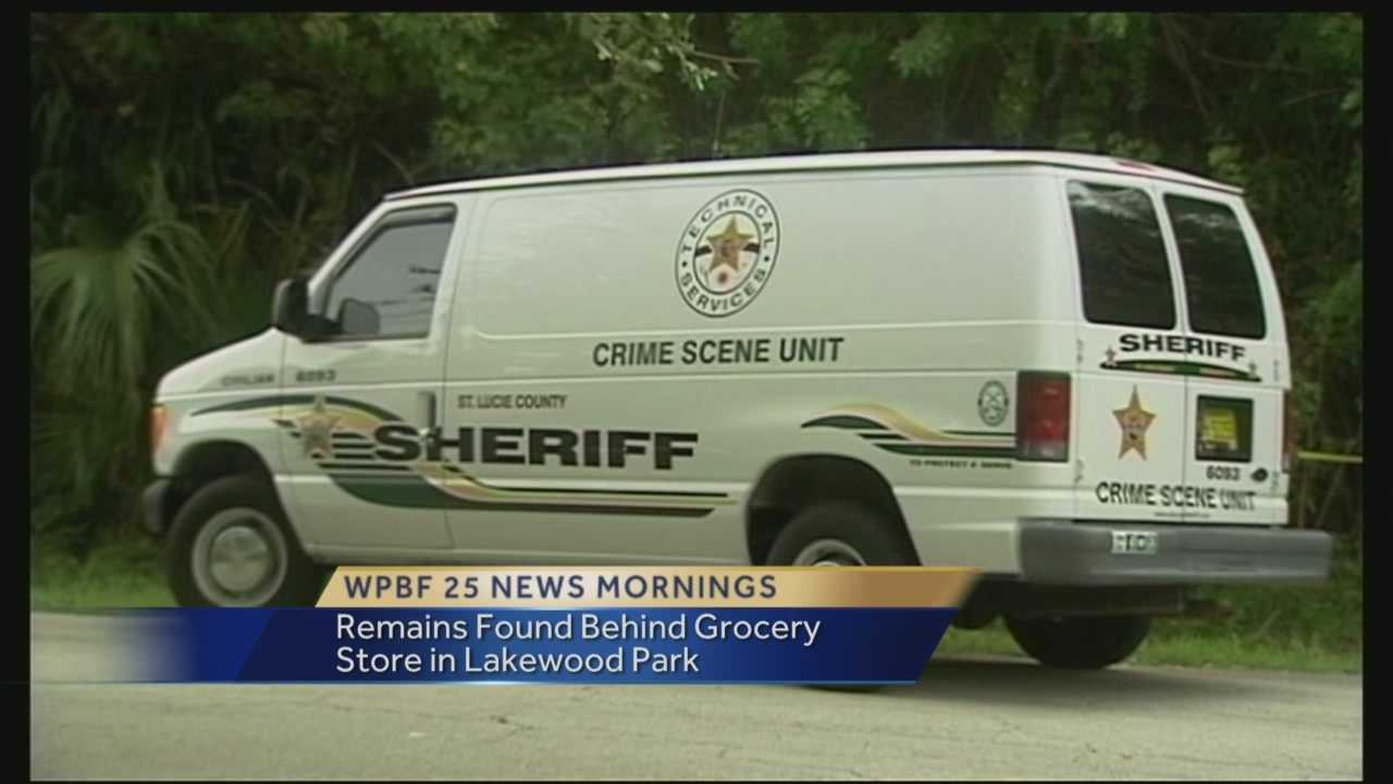 A body was found Saturday behind a grocery store in St. Lucie County.