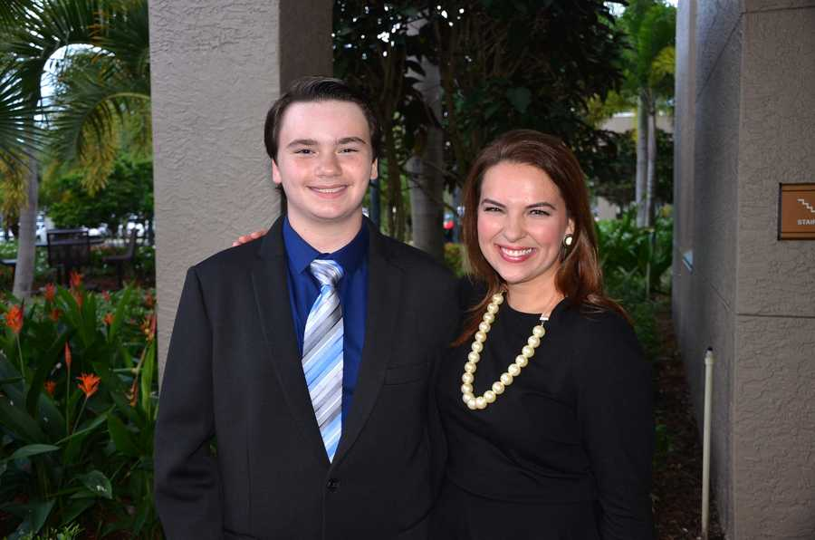 Essay-1 = Brandon S. Gitto, First prize winner Brandon Gitto with Stephanie Berzinski, WPBF-25 Anchor.