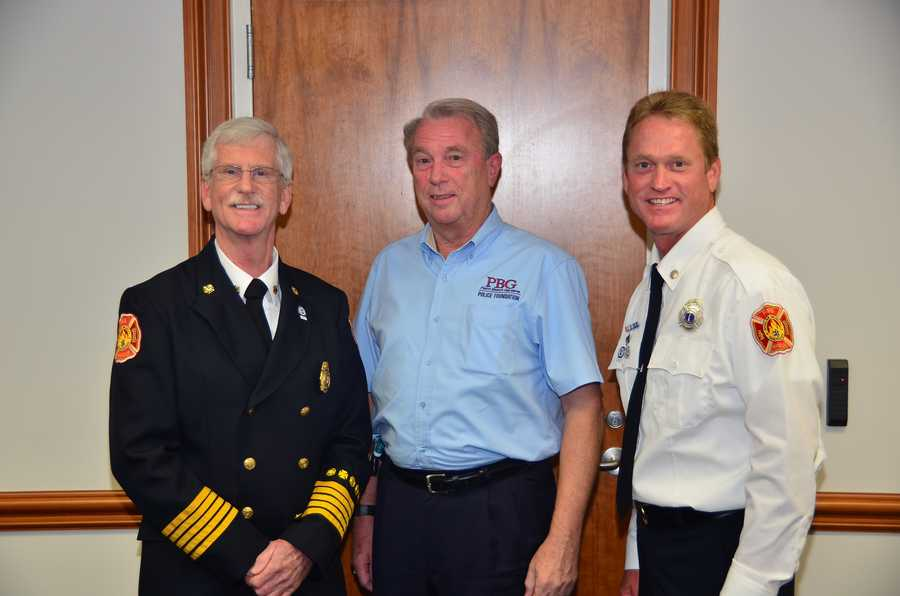 Essay-5 = L-R Palm Beach Gardens Fire Chief Michael Southard, Palm Beach Gardens Police Foundation President Tom Murphy, Palm Beach Gardens Fire Lieutenant Jason O'Brien.