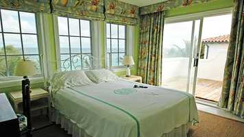 This bedroom boasts private entrance to a spacious balcony overlooking the sea.