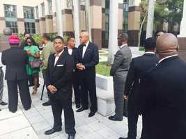 Members of the Nation of Islam waiting for family to speak.