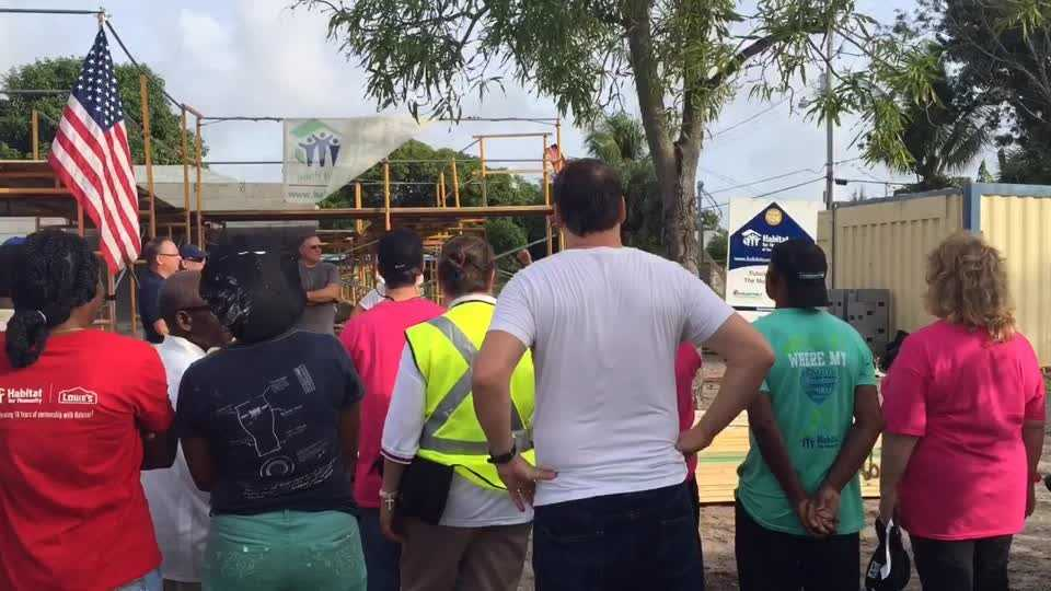 Volunteers work on Habitat For Humanity
