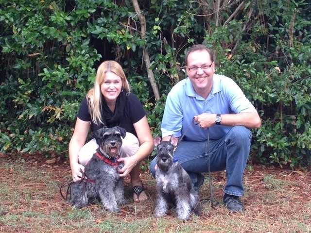 Assistant News Director Travis Sherwin, his wife Catrina and their dogs Barrister and Macro.