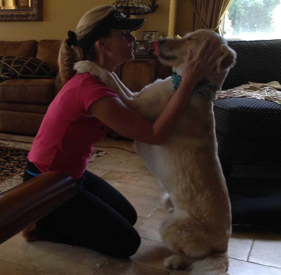 General Manager Caroline Taplett and her dog Sampson.