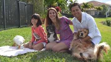 WPBF 25 News reporter Ari Hait, his wife Rebecca, their daughter Haley and their dogs Elphaba, the golden retriever, and Adelaide. The duck is Lumpy.