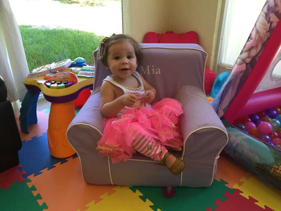 Mia enjoying her personalized chair in a tutu!