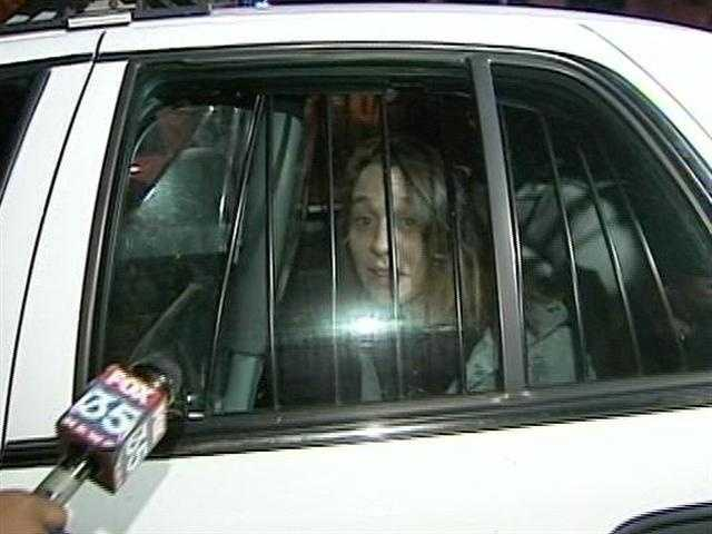 Angela Pike proclaims her innocence as she is put in the back of a deputy's cruiser and taken to jail. She is accused of helping Leviticus Taylor escape from the Indian River County Jail.